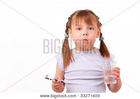 Little Girl With A Tooth Brush And A Glass With Water
