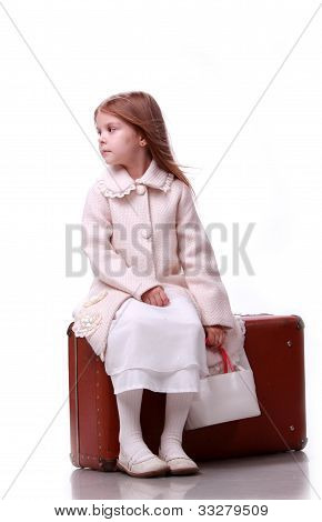 Lovely girl on the suitcase