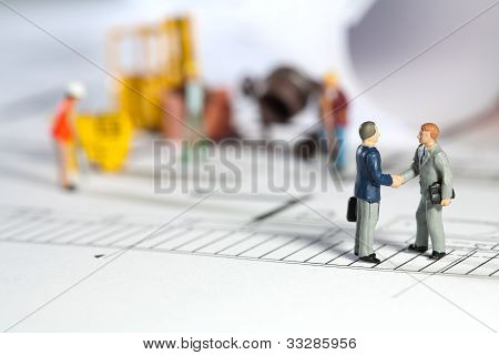 Architect And Property Owner Shaking Hands
