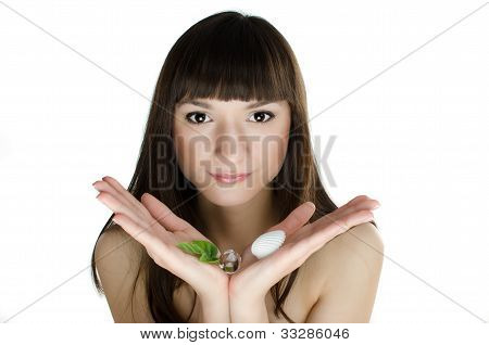 Beautiful Girl In Spa Holding Near Her Face Fresh Green Leaf And Shell