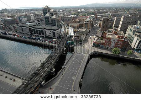 Liffey river flowing through Dublin aerial view.