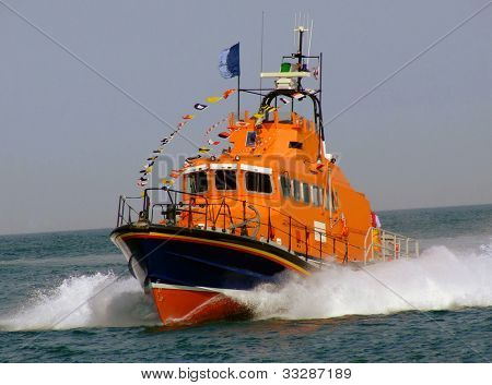 Close up of lifeboat sailing on ocean.