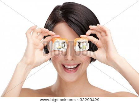 Young girl holding sushi in her hand and smiling, isolated on white background on white