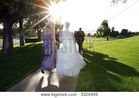 Bridal party into sunset
