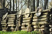 stock photo of stockade  - Stockade fence around a wooden fortress - JPG
