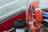 Orange Lifebuoy On A Boat For The Safety Of People. Rescue Props On A Boat. A Floating Boat At Sea,  poster