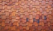stock photo of red siding  - New section of a red shake cedar or redwood roof - JPG