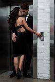 Beautiful Sensual Couple Hugging And Flirting Near Lift poster
