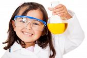 stock photo of protective eyewear  - Happy little girl playing at the lab  - JPG