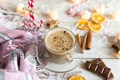 Hot Cup Of Cappuccino Or Hot Milk Chocolate With Dried Orange Fruit And Cinnamon. poster