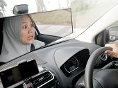 Portrait Of Female Asian Muslim Driver Shocked And Panic About To Have Crash Accident poster