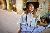 Beautiful Happy Woman Walking On Street on vacation with sightseeing city with map poster