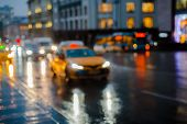 Wet Night City Street Rain Bokeh Reflection Bright Colorful Lights Puddles Sidewalk. Car Headlights  poster