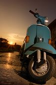pic of vespa  - vespa parked nearby the lake at the sunset - JPG