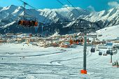 Stunning Alpine Winter Ski Resort In French Alps. Amazing Cityscape With Ski Lifts, Cable Cars And F poster