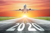 The Inscription On The Runway 2020 Surface Of The Airport Runway With Take Off Airplane. Concept Of  poster
