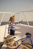 Baby Boy Enjoy Vacation Sea Cruise Ship. Child Sailor. Boy Sailor Travelling Sea. Boy Sailor Striped poster
