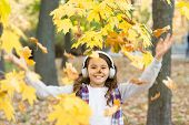 Melody Of Autumn. Schoolgirl Listening Modern Headphones. Headphones Technology. Falling Leaves. Hap poster