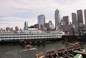 Seattle Waterfront Skyline With A Ferry Boat In The Puget Sound Docked Downtown In The Travel Citysc poster