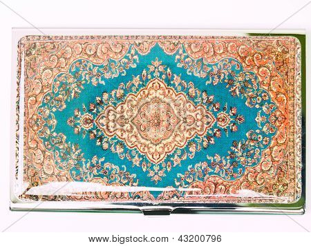 A Colorful Arabesque Patternon The Metalic Business Card Cover Isolated On White Background
