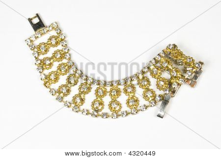 Bracelet From A Beads Of Gold, Metal And Jewels Of White Colour
