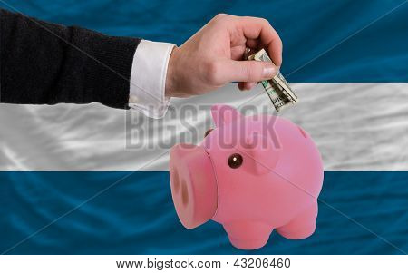 Dollar Into Piggy Rich Bank And  National Flag Of El Salvador