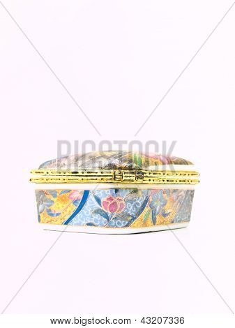 A Used Luxurious Small Ceramic Box With Golden Trim Flowral Pattern Isolated On White Background In