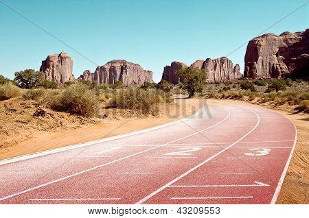 Tartan Racetrack Between Mountains