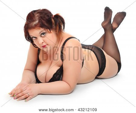 Overweight woman dressed in retro lingerie on a white background.