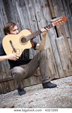 Rough Country Guy Holding His Guitar