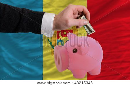 Dollar Into Piggy Rich Bank And  National Flag Of Moldova