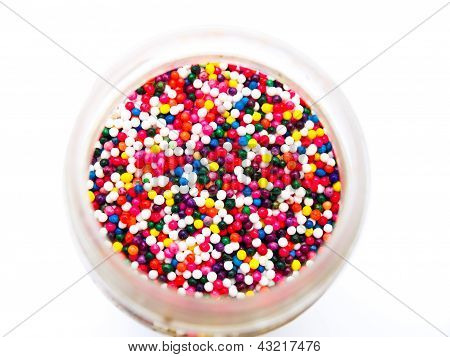 Sugar Sprinkle Dots In A Bottle Isolated In White Background From Topview