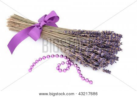 Lavender herb flower posy with lilac bead strand over white background. Lavandula.