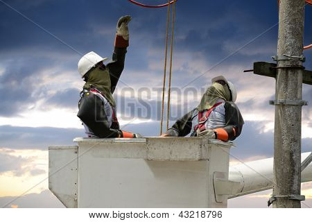 Electricians on a crane.