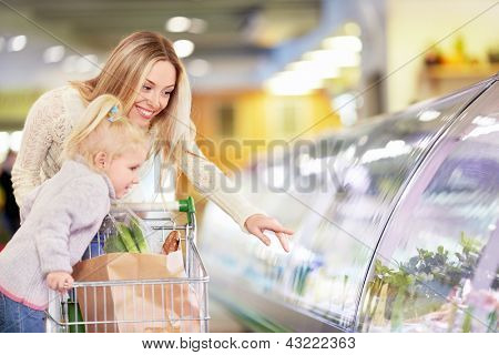 Mother and daughter in the store
