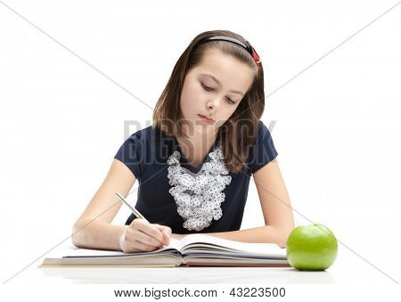 Young schoolgirl is doing her homework, isolated, white background