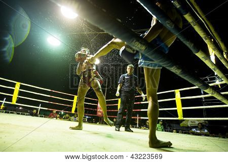 CHANG, THAILAND - FEB 22: Unidentified Muay Thai fighters compete in an amateur kickboxing match, Feb 22, 2013 on Chang, Thailand. Muay Thai practiced over 120000 fans and nearly 10000 professionals.