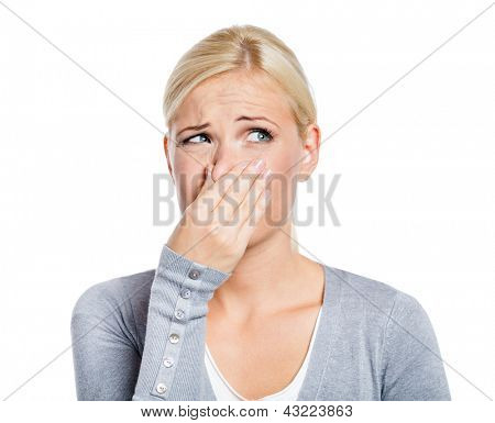 Lady covers nose with hand showing that something stinks, isolated on white