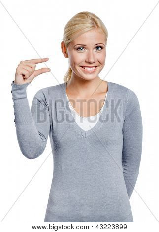 Woman showing small amount of something with fingers, isolated on white