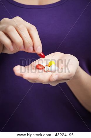 Woman takes painkillers, isolated on white. Prescription medication