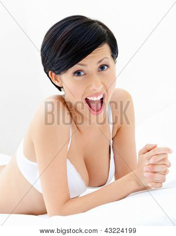 Woman in underwear is lying in the bedstead, isolated on white background