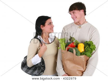 Smiling Young Couple With Groceries Shopping