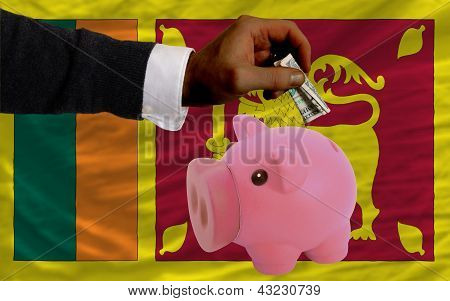 Dollar Into Piggy Rich Bank And  National Flag Of Srilanka