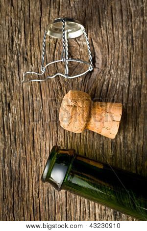 champagne cork and bootle on old wooden table