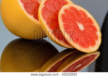 mirroring an orange. representative photo of healthy vitamins from fresh fruit