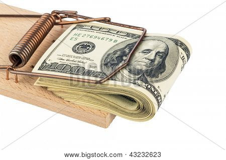 u.s. dollar bills in a mousetrap. symbolic photo for debt
