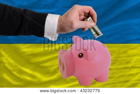 Dollar Into Piggy Rich Bank And  National Flag Of Ukraine
