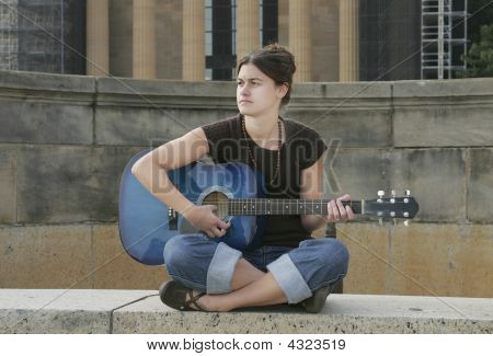 Woman Guitarist Playing