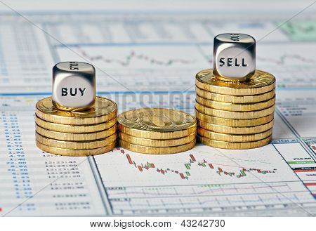 Financial Chart, Coins And Dice Cubes With The Words Sell Buy. Selective Focus