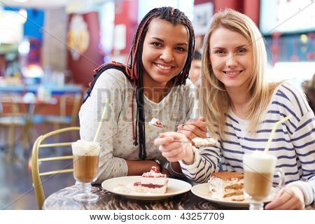 Image of two teenage girls spending time in cafe